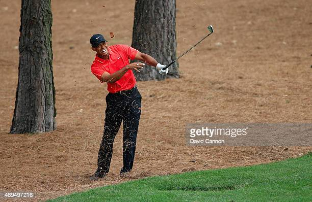 Tiger Woods of the United States reacts to a shot from the pine straw on the ninth hole during the final round of the 2015 Masters Tournament at...