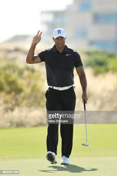 Tiger Woods of the United States reacts to his birdie on the eighth green during the first round of the Hero World Challenge at Albany, Bahamas on...