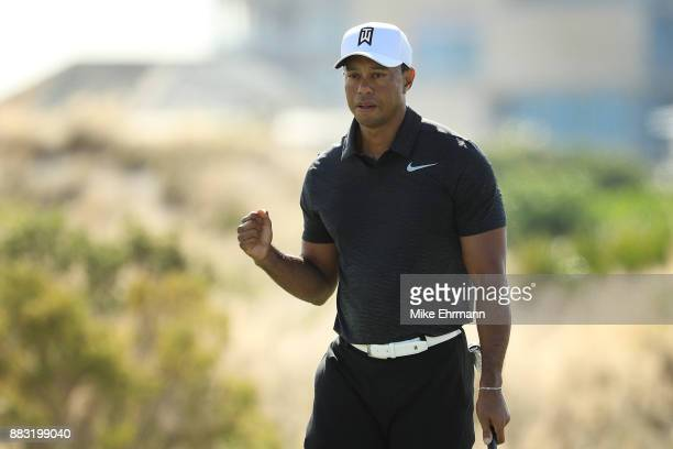 Tiger Woods of the United States reacts to his birdie on the eighth green during the first round of the Hero World Challenge at Albany Bahamas on...
