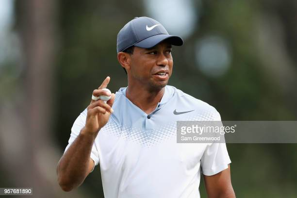 Tiger Woods of the United States reacts to his birdie on the seventh green during the third round of THE PLAYERS Championship on the Stadium Course...