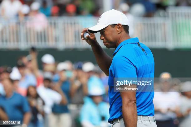 Tiger Woods of the United States reacts to his eagle on the ninth green during the first round of THE PLAYERS Championship on the Stadium Course at...