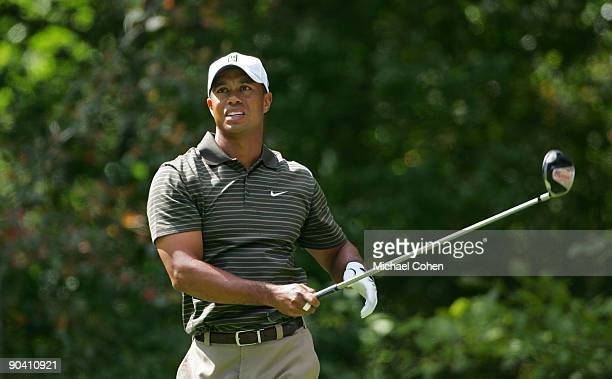 Tiger Woods of the United States reacts to his errant drive on the second hole during the third round of the Deutsche Bank Championship at TPC Boston...
