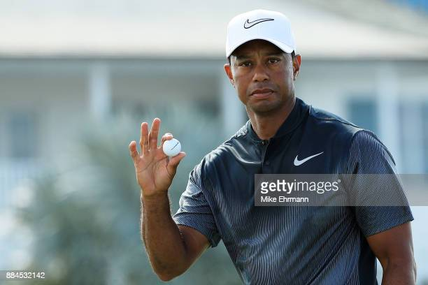 Tiger Woods of the United States reacts to his par on the fifth green during the third round of the Hero World Challenge at Albany Bahamas on...
