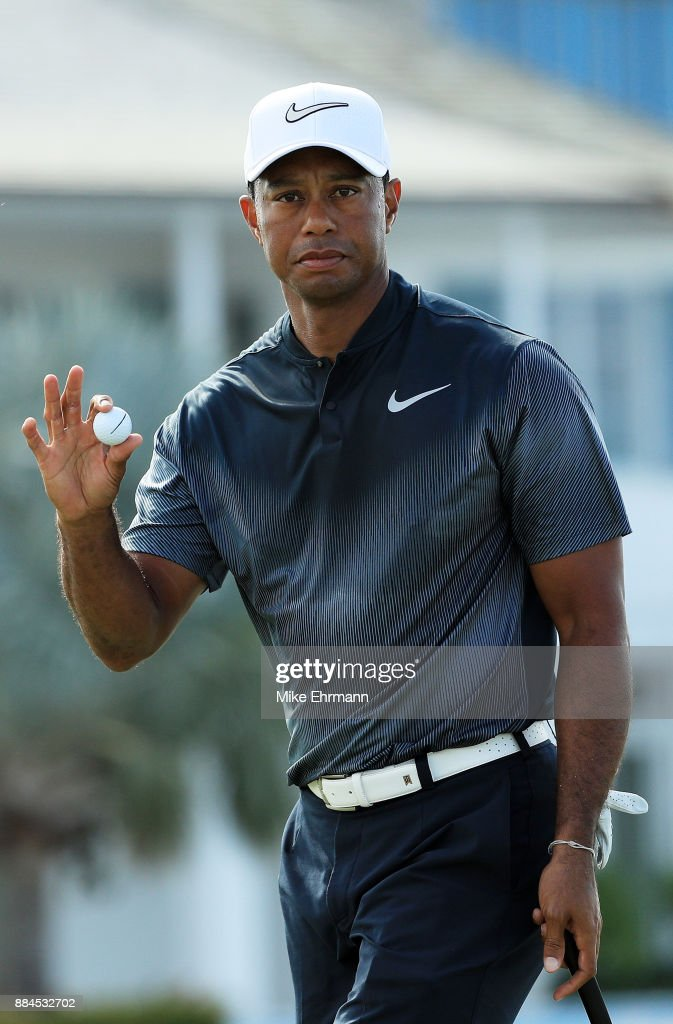 Tiger Woods of the United States reacts to his par on the fifth green during the third round of the Hero World Challenge at Albany, Bahamas on December 2, 2017 in Nassau, Bahamas.