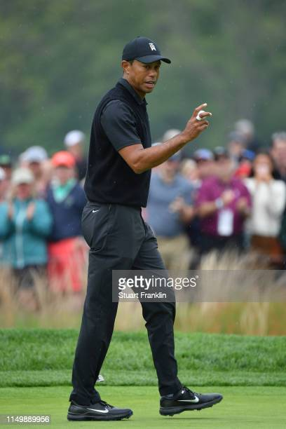 Tiger Woods of the United States reacts to his putt on the first green during the second round of the 2019 PGA Championship at the Bethpage Black...