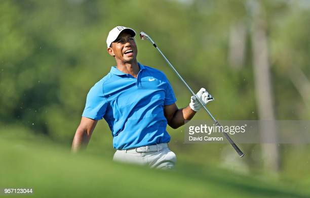 Tiger Woods of the United States reacts to his second shot on the par 4, 14th hole during the first round of the THE PLAYERS Championship on the...