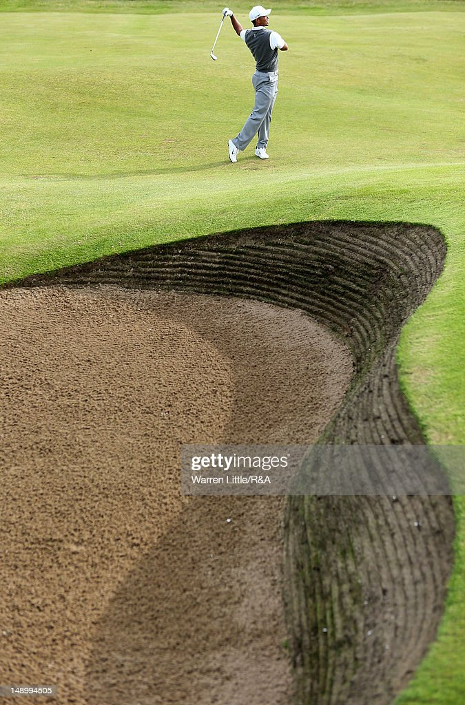 Tiger Woods of the United States reacts to his second shot on the 11th hole during the third round of the 141st Open Championship at Royal Lytham & St. Annes Golf Club on July 21, 2012 in Lytham St Annes, England.