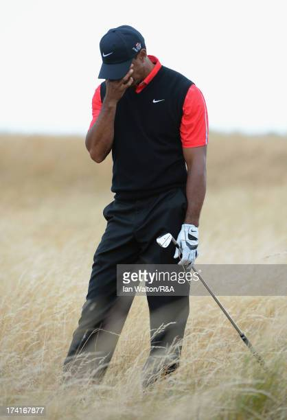 Tiger Woods of the United States reacts to his second shot on the 11th hole during the final round of the 142nd Open Championship at Muirfield on...
