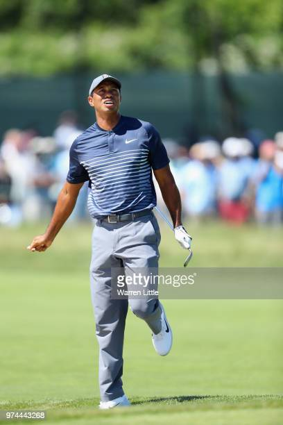 Tiger Woods of the United States reacts to his second shot on the fourth hole during the first round of the 2018 US Open at Shinnecock Hills Golf...