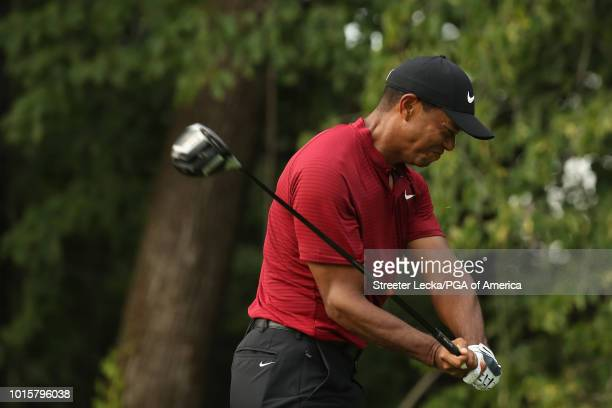 Tiger Woods of the United States reacts to his shot from the 17th tee during the final round of the 2018 PGA Championship at Bellerive Country Club...