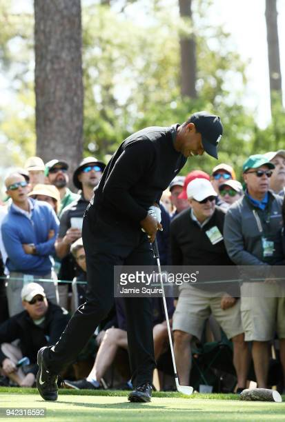 Tiger Woods of the United States reacts to his tee shot on the fourth hole during the first round of the 2018 Masters Tournament at Augusta National...