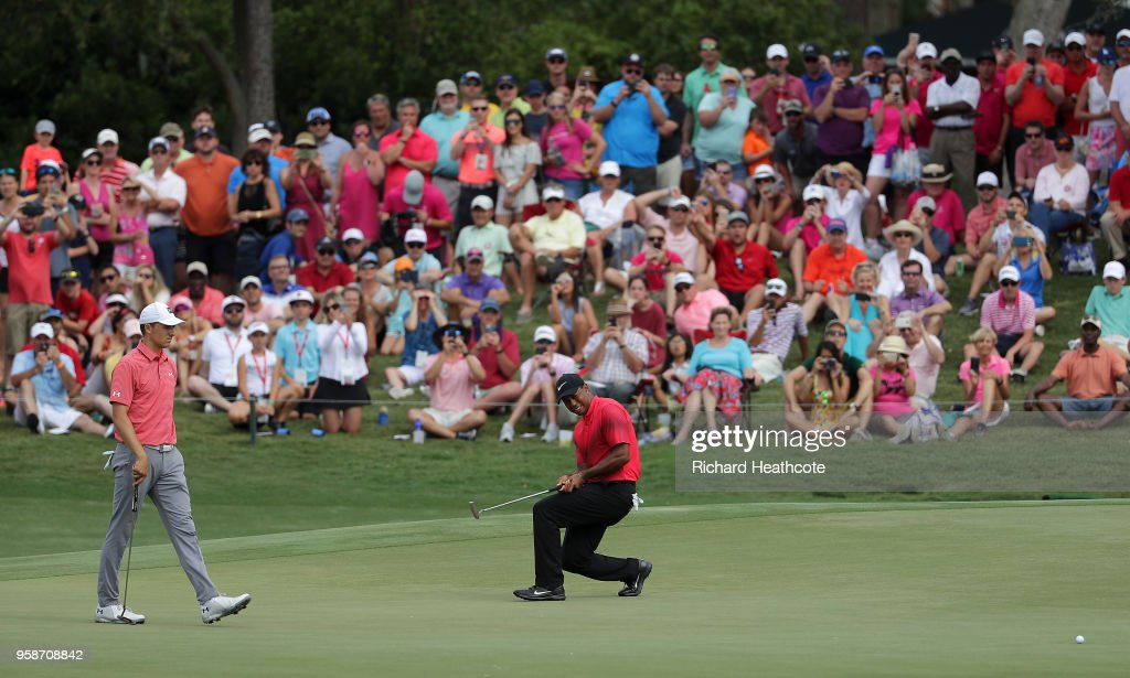 Tiger Woods of the United States reacts to just missing an eagle putt on the 11th green during the final round of THE PLAYERS Championship on the Stadium Course at TPC Sawgrass on May 13, 2018 in Ponte Vedra Beach, Florida.