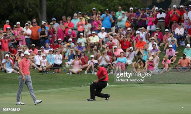 Tiger Woods of the United States reacts to just missing an eagle putt on the 11th green during the final round of THE PLAYERS Championship on the...