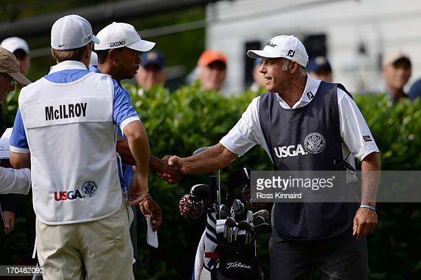 Tiger Woods of the United States shakes hands with Steve Williams prior to teeing off during Round One of the 113th U.S. Open at Merion Golf Club on...