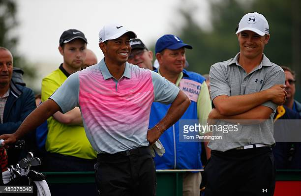 Tiger Woods of the United States shares a joke with Jordan Spieth of the United States during the third round of The 143rd Open Championship at Royal...