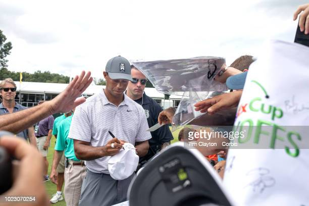 Tiger Woods of The United States signs autographs after his practice round before the start of The Northern Trust FedEx Cup Playoffs on August 23rd...