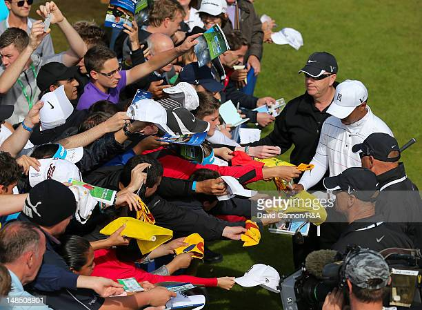 Tiger Woods of the United States signs autographs during the third practice round prior to the start of the 141st Open Championship at Royal Lytham...