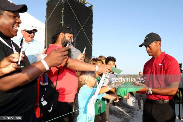 Tiger Woods of the United States signs autographs following the final round of the Hero World Challenge at Albany Bahamas on December 02 2018 in...