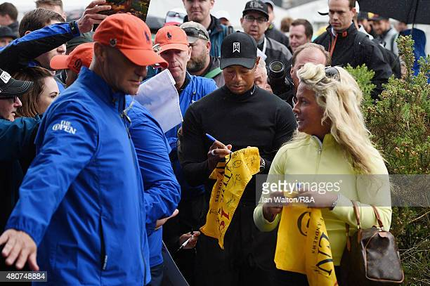 Tiger Woods of the United States signs his autograph for fans ahead of the 144th Open Championship at The Old Course on July 15 2015 in St Andrews...