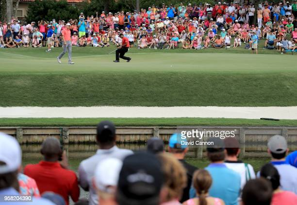 Tiger Woods of the United States sinks to his knees in frustration after just missing an eagle putt on the par 5, 11th hole during the final round of...