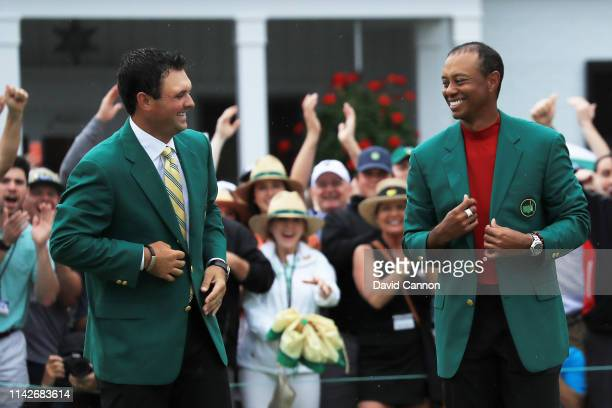Tiger Woods of the United States smiles after being awarded the Green Jacket by Masters champion Patrick Reed during the Green Jacket Ceremony after...