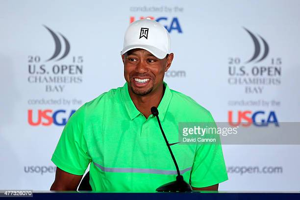 Tiger Woods of the United States smiles as he talks to the media during a press conference prior to the start of the 115th U.S. Open Championship at...