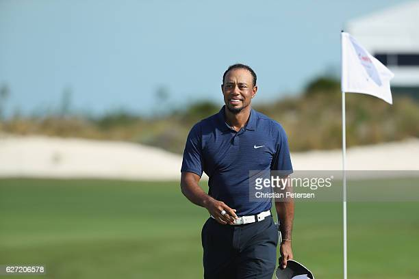 Tiger Woods of the United States smiles as he walks across the 18th green during round two of the Hero World Challenge at Albany The Bahamas on...