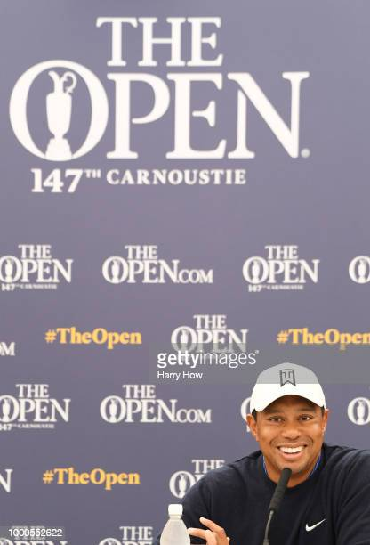 Tiger Woods of the United States smiles at a press conference during previews to the 147th Open Championship at Carnoustie Golf Club on July 16 2018...