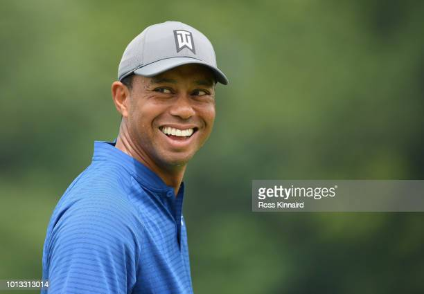 Tiger Woods of the United States smiles during a practice round prior to the 2018 PGA Championship at Bellerive Country Club on August 8 2018 in St...