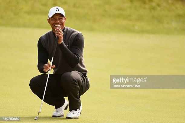 Tiger Woods of the United States smiles on the 18th green during the Champion Golfers' Challenge ahead of the 144th Open Championship at The Old...