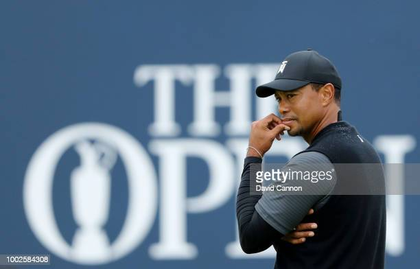 Tiger Woods of the United States stands beside the green on the 18th hole during the second round of the 147th Open Championship at Carnoustie Golf...