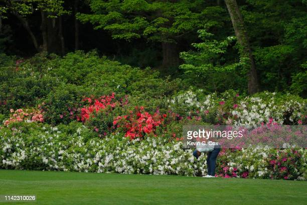 Tiger Woods of the United States stretches on the 13th hole during the second round of the Masters at Augusta National Golf Club on April 12 2019 in...
