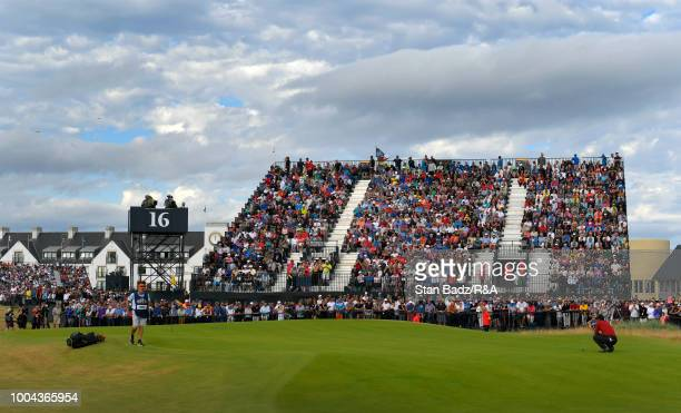 Tiger Woods of the United States studies his putt on the 16th hole during the final round of the 147th Open Championship at Carnoustie Golf Club on...