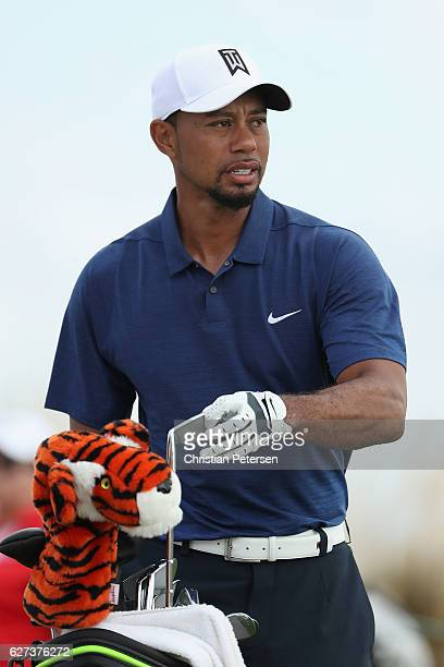 Tiger Woods of the United States take a iron from his bag during round two of the Hero World Challenge at Albany The Bahamas on December 2 2016 in...