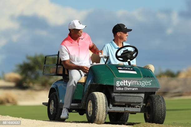 Tiger Woods of the United States talks to Golf Channel reporter Jim 'Bones' Mackay during the proam prior to the Hero World Challenge at Albany...