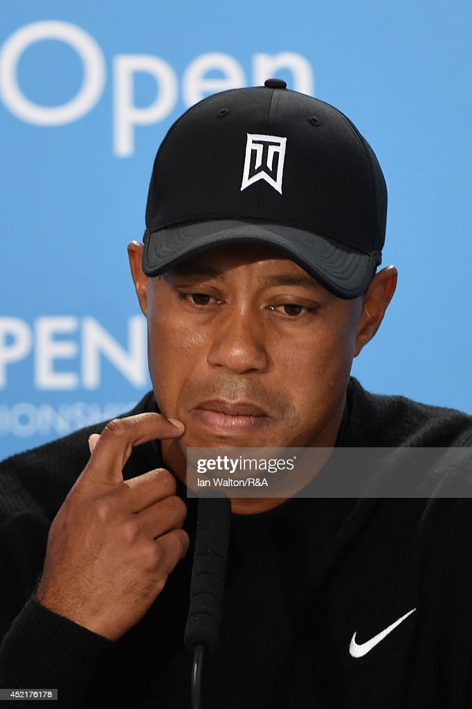 Tiger Woods of the United States talks to the media during a press conference after a practice round prior to the start of The 143rd Open Championship at Royal Liverpool on July 15, 2014 in Hoylake, England.
