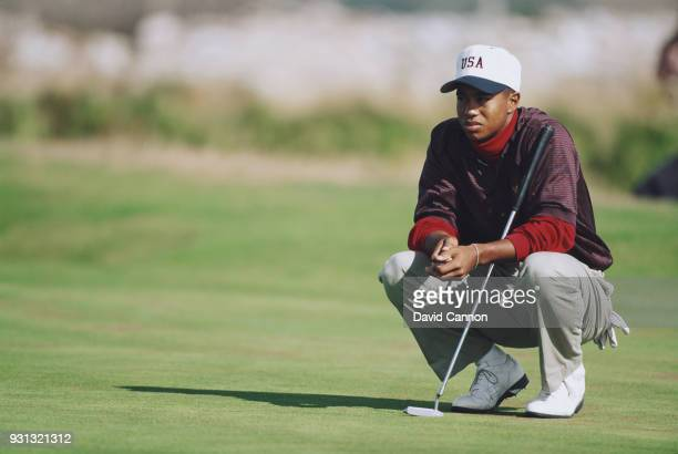 Tiger Woods of the United States team lines up a putt in his match with Gary Wolstenholme during the Walker Cup at Royal Porthcawl Golf Club on...