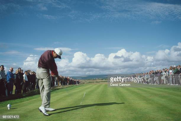Tiger Woods of the United States team plays a tee shot in his match with Gary Wolstenholme during the Walker Cup at Royal Porthcawl Golf Club on...