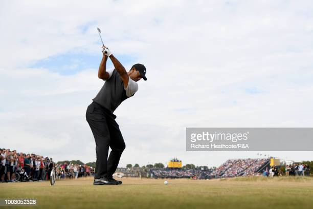 Tiger Woods of the United States tees off at the 16th hole during round three of the Open Championship at Carnoustie Golf Club on July 21 2018 in...