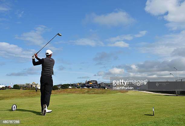 Tiger Woods of the United States tees off on the 17th during the Champion Golfers' Challenge ahead of the 144th Open Championship at The Old Course...