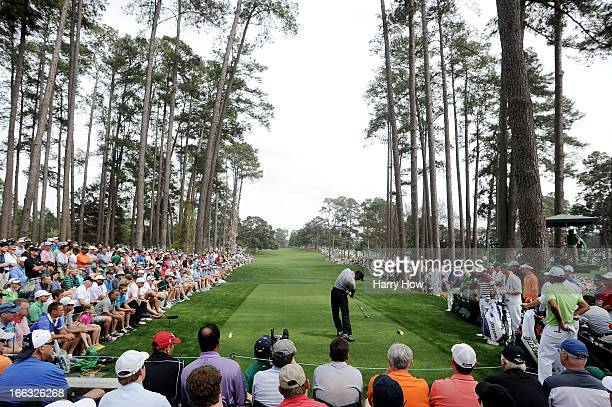 Tiger Woods of the United States tees off on the 17th hole during the first round of the 2013 Masters Tournament at Augusta National Golf Club on...