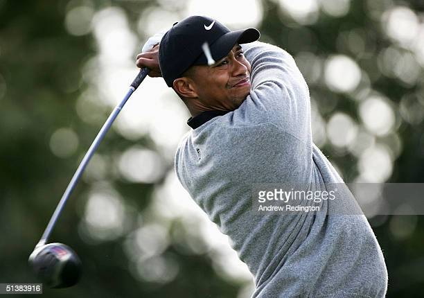 Tiger Woods of the United States tees off on the fifth hole during the third round of the American Express Championship on October 2, 2004 at Mount...
