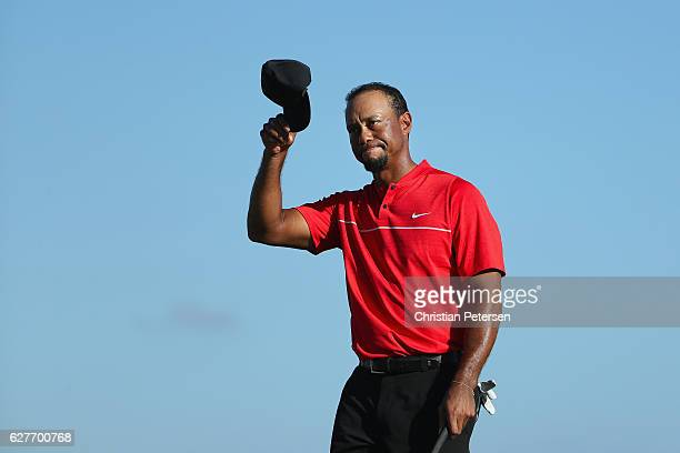 Tiger Woods of the United States tips his cap on the 18th hole during the final round of the Hero World Challenge at Albany The Bahamas on December 4...
