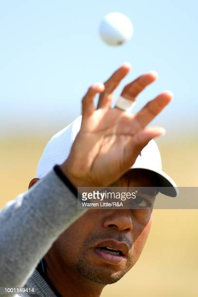 Tiger Woods of the United States tosses his ball in the air on the driving range during previews to the 147th Open Championship at Carnoustie Golf...