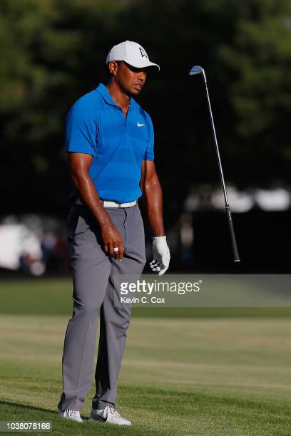 Tiger Woods of the United States tosses his club on the 16th hole during the third round of the TOUR Championship at East Lake Golf Club on September...