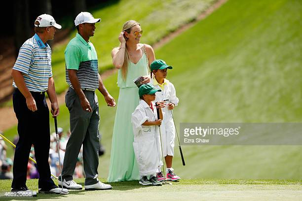 Tiger Woods of the United States waits alongside his girlfriend Lindsey Vonn son Charlie and daughter Sam and friend Steve Stricker during the Par 3...