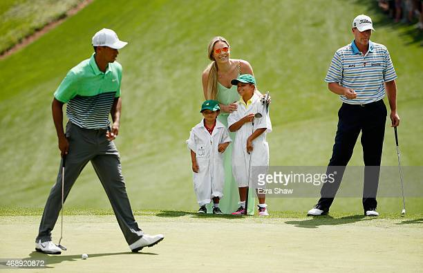 Tiger Woods of the United States waits alongside his girlfriend Lindsey Vonn son Charlie and daughter Sam and friend Steve Strickerduring the Par 3...