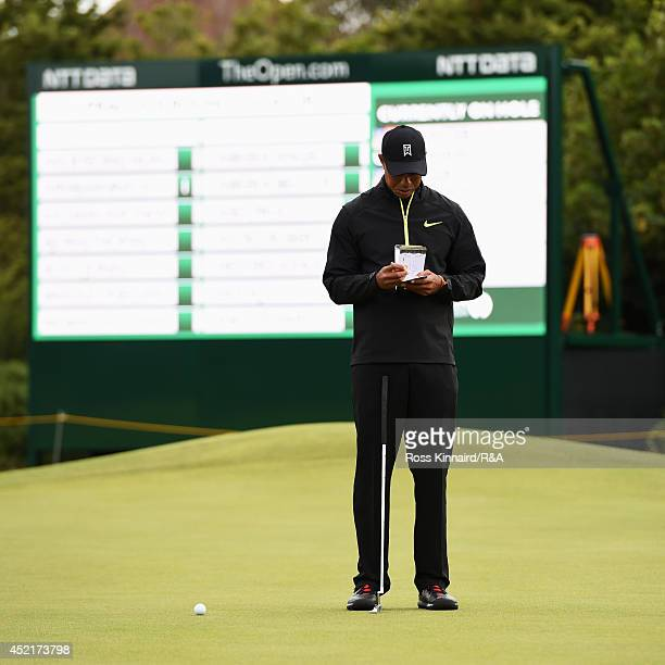 Tiger Woods of the United States waits on a green during a practice round prior to the start of The 143rd Open Championship at Royal Liverpool on...