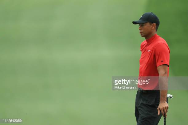 Tiger Woods of the United States waits on the seventh green during the final round of the Masters at Augusta National Golf Club on April 14, 2019 in...