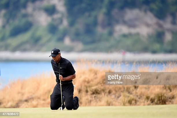 Tiger Woods of the United States waits on the third green during the first round of the 115th U.S. Open Championship at Chambers Bay on June 18, 2015...